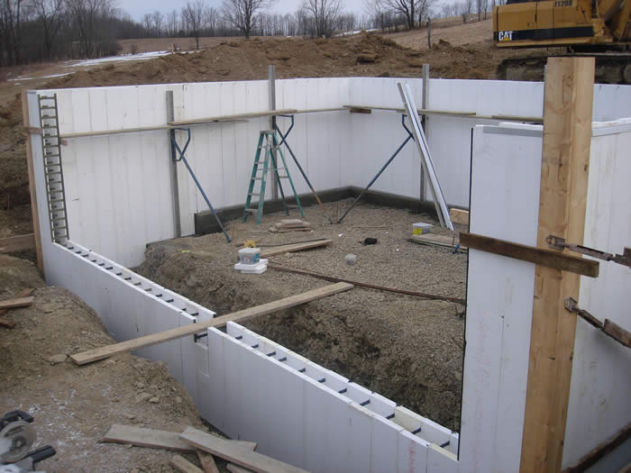 Best built general construction our process house for Basement foundation construction